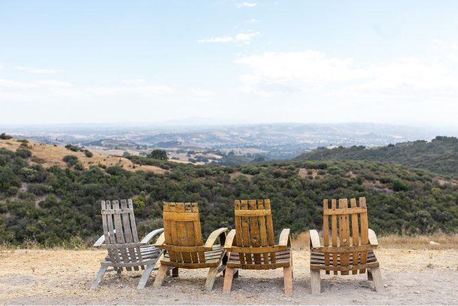 four relaxing chairs overlooking the Paso Robles vineyards at Calcareous Vineyard