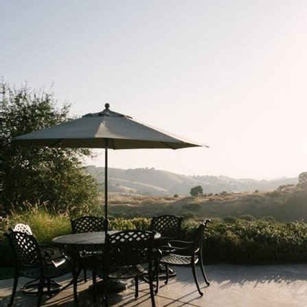 A shaded patio table at Calcareous Vineyard Winery in Paso Robles